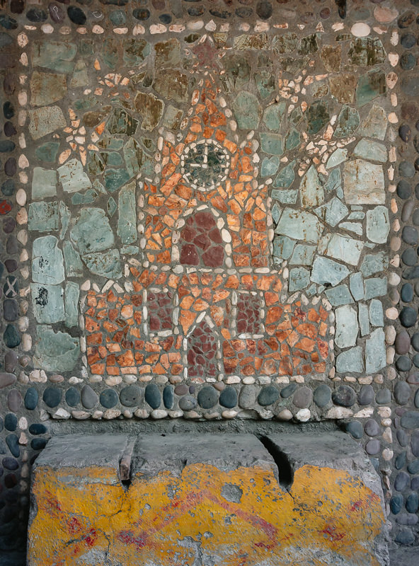 A very non-Tajik looking church, done mosaic fashion inside a Western Pamir Soviet bus stop in Tajikistan