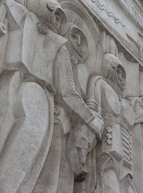 A detailed heroic view of the cosmonauts of the Arman Cinema. This dramatic bas-relief shows three men in spacesuits, ready to begin their journey.