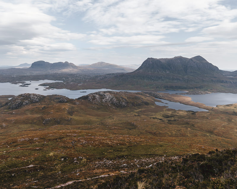 The view to the north from Stac Pollaidh: Cùl Mòr rises behind Loch Sionascaig, with the distinctive form of Suilven seen in the distance