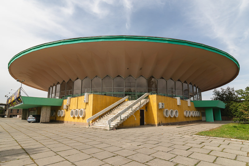 The yellow and green flying saucer shaped Soviet era State Circus in Bishkek