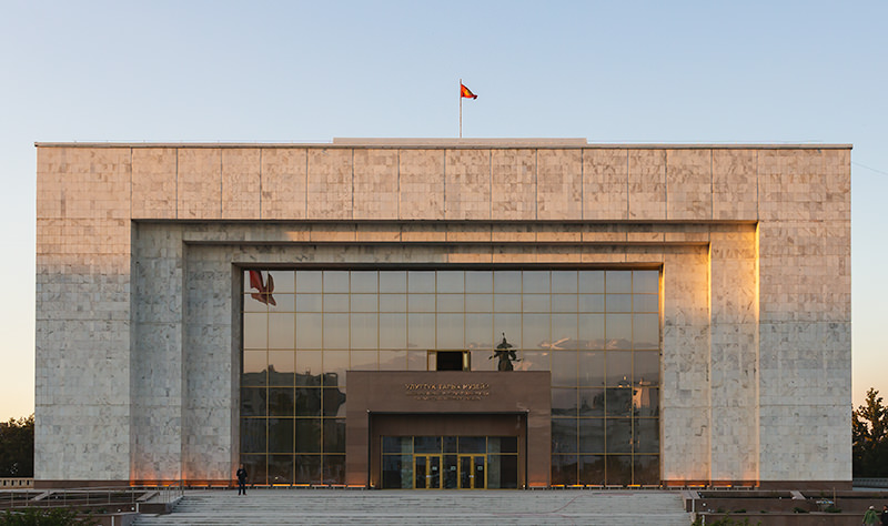 The huge marble cube shaped State History Museum in Bishkek, with the Ala Too mountains reflected in the glass front