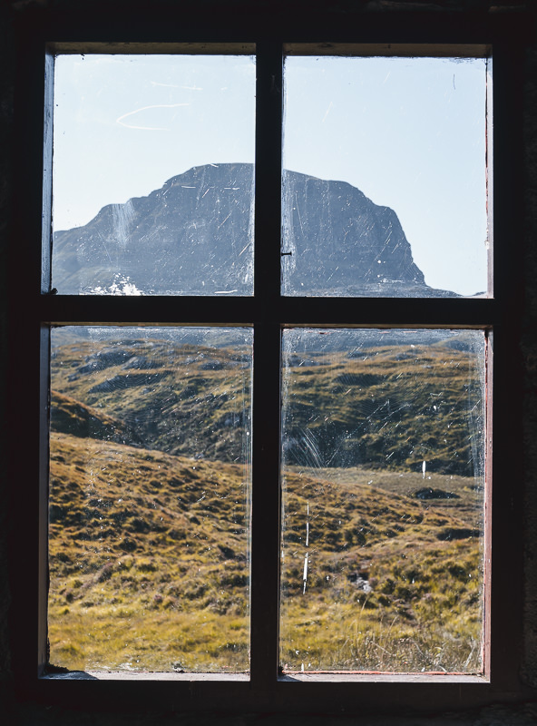 The iconic dome of the Scottish mountain Suilven, seen through Suileag Bothy window