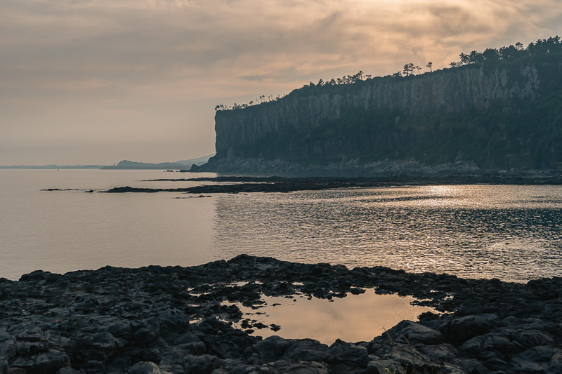 Sunset over the cliffs above Daepyeong on Jeju