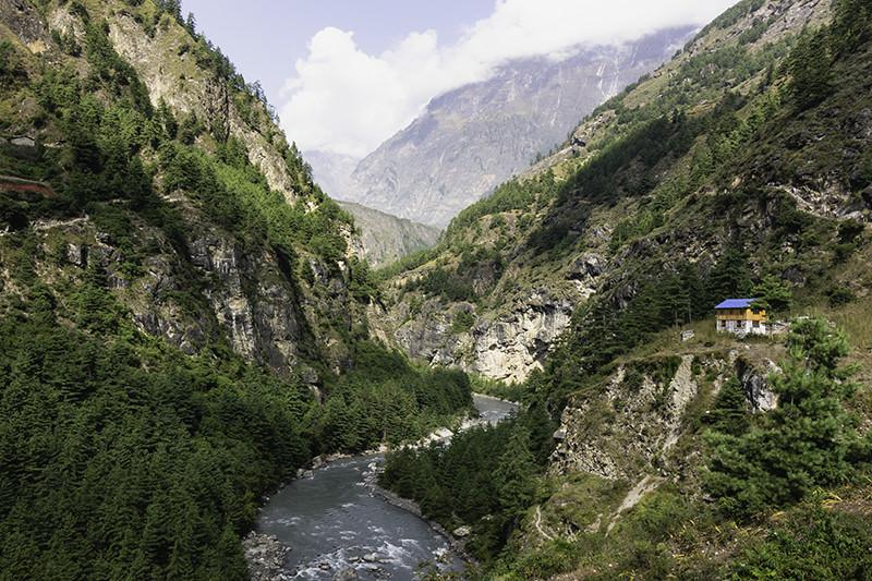 The Budhi Gandaki snakes up through forested slopes in the Manaslu Region, Nepal