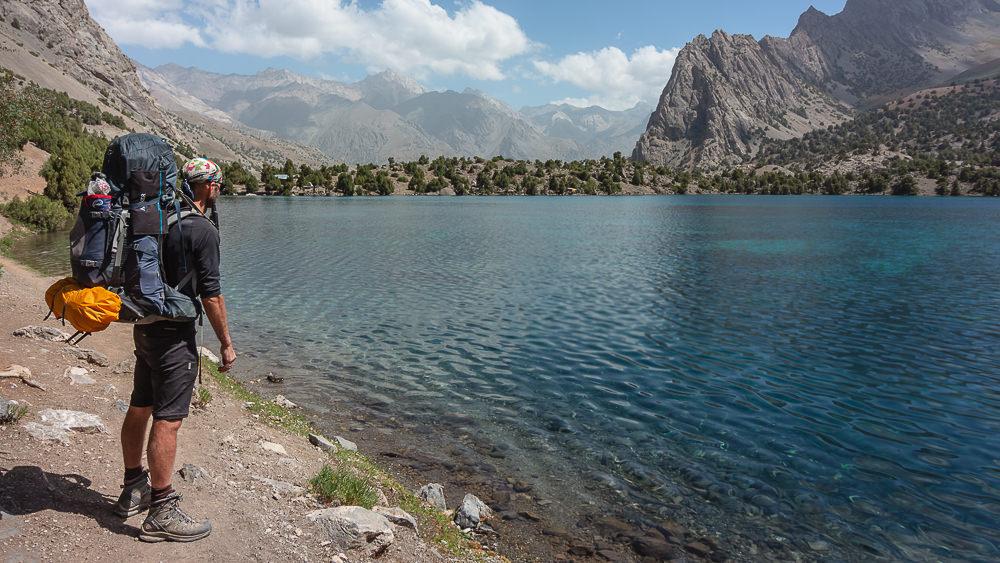 Walking the shoreline of Alauddin Lake while Fann Mountains trekking in Tajikistan