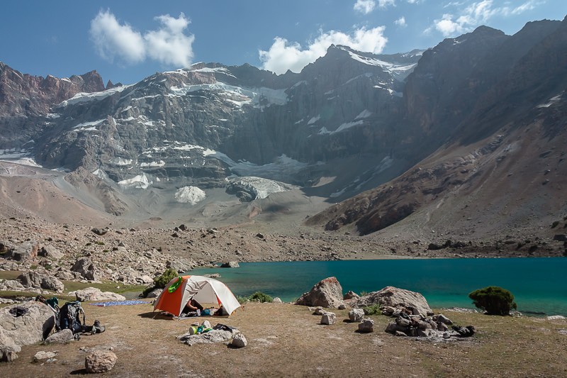 Camping at Lake Dushakha beneath the towering Mt. Mirali in the Fann Mountains