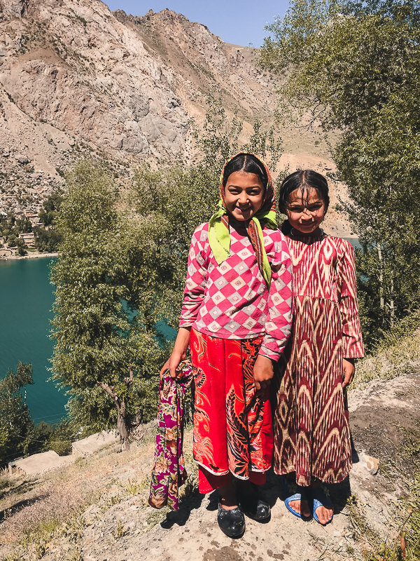 Girls fetching water above Marguzor Lake in Tajikistan's Fann Mountains