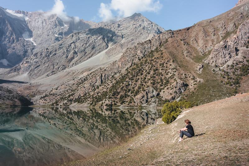 Taking in the view on the shore of Kulikalon while Fann Mountains trekking in Tajikistan
