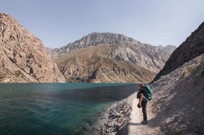 Hiking along the trail next to the 7th lake of the Haft Kul while Fann Mountains trekking in Tajikistan