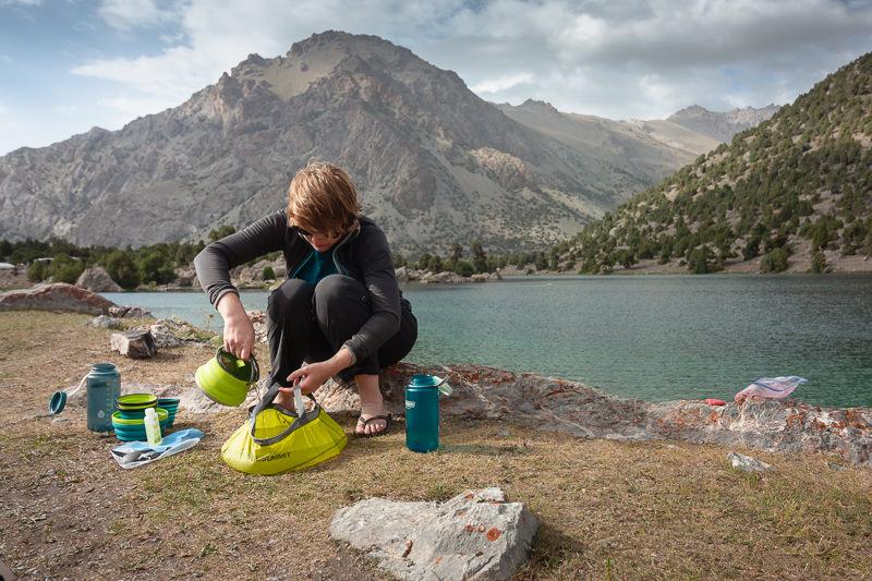 Doing the dishes at Bibidzhonat Lake while Fann Mountains trekking in Tajikistan