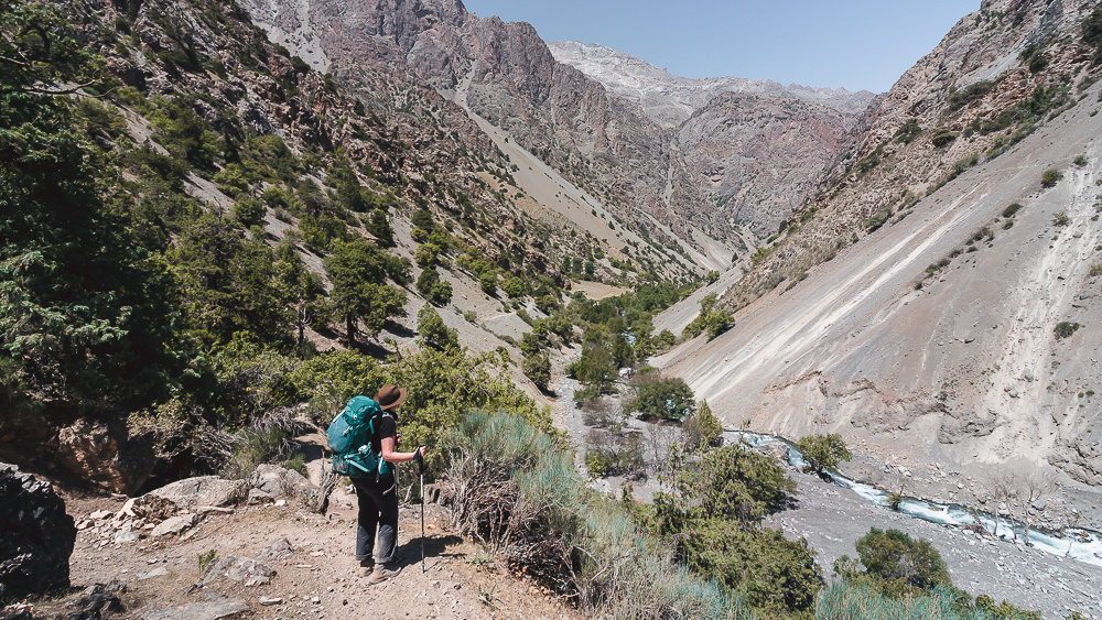 Descending towards the Sarymat River while Fann Mountains trekking in Tajikistan