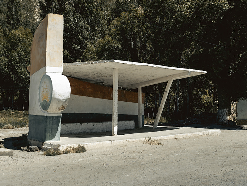A sweeping and curved Soviet bus stop done in the style of the Tajikistan flag. This beauty is located at Ishkashim, very close to the border with Afghanistan