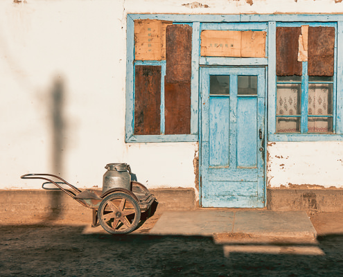 A house front in the village of Karakul in Tajikistan, shining in the early morning sun.