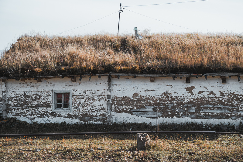 A thick layer of turf and grass on the roof of stones cottages like this provides insulation throughout the cold winter on the shores of Paravani Lake in Javakheti
