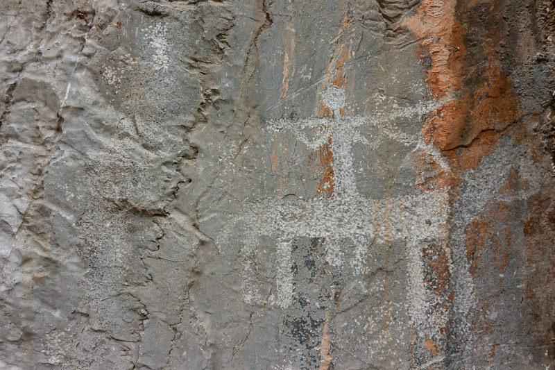 Petroglyph of hunter on horseback on rock in Tawi Village in Musandam