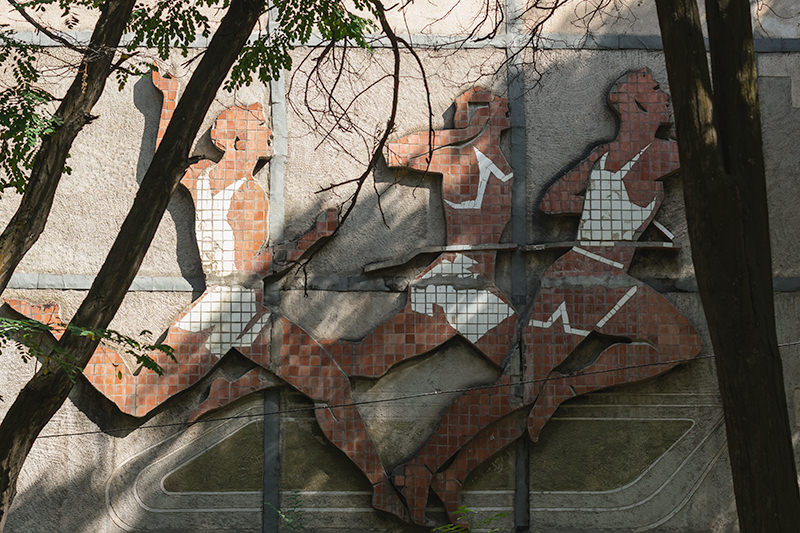 The Soviet mosaic 'Male Athletes' in the 5th microdistrict of Bishkek