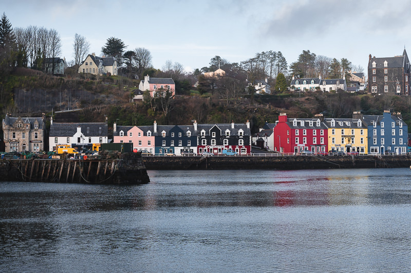 Colourful houses line the waterfront of Tobermory, the main town on the Isle of Mull in Scotland