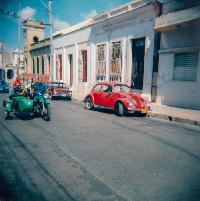 Cuba on Film: Traditional Cars and Motorbike on the Streets of Cienfuegos, Cuba