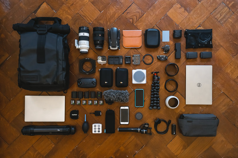 A flat lay on parquet flooring of all our travel photography gear