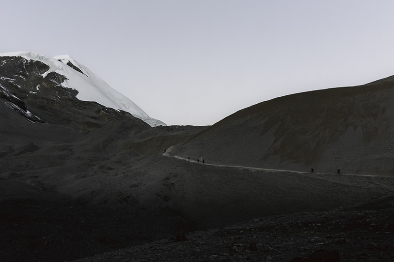 Trekkers on the Thorong La trail at daybreak