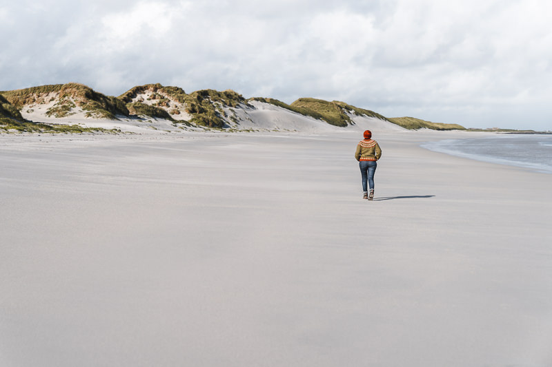 A person walks along the unspoiled beach of the Tresness Peninsula on Sanday