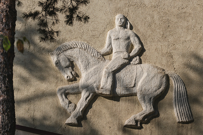 Unknown horesman bas-relief on a building near Panfilov Park in Bishkek