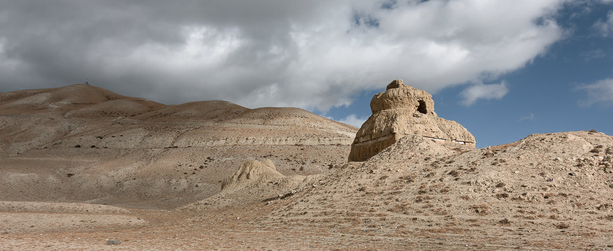 Sandy coloured ruins by the roadside on the way to Chhoser in Upper Mustang