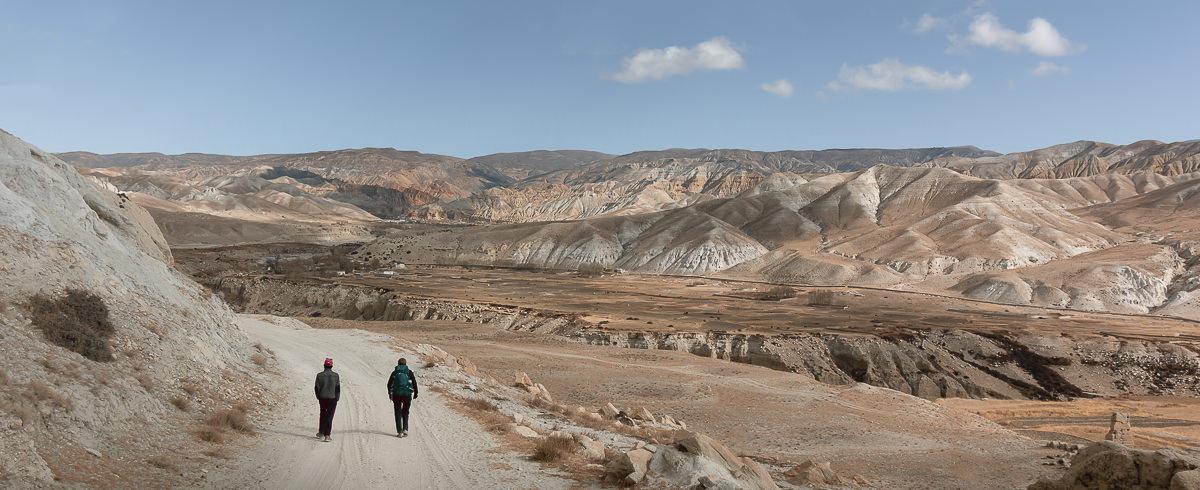 Two trekkers on a trail towards Chhoser in Upper Mustang