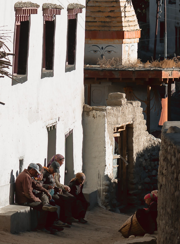 With the days work done, men and women relax in the sfternoon sun on the streets of Ghami in Upper Mustang.