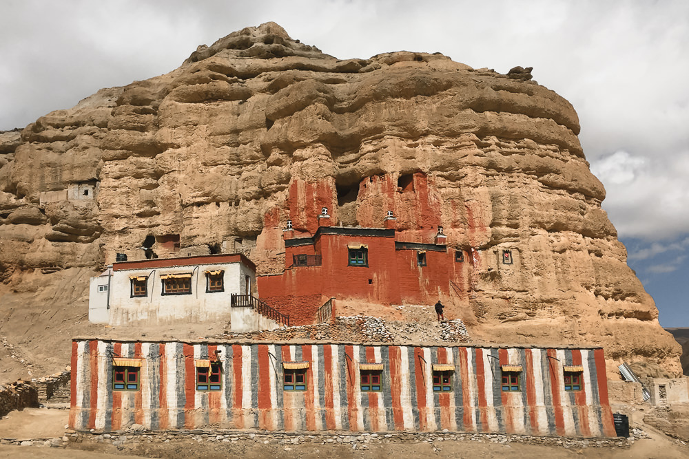Bright red Nyphu Gompa, built into the cliffside