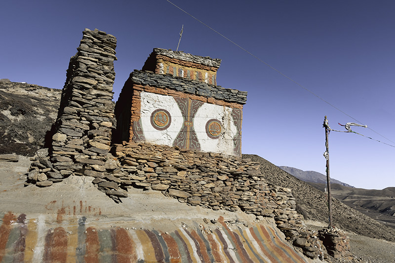 A colourful chorten in good condition on the Upper Mustang trek has a design that looks like the face of an owl