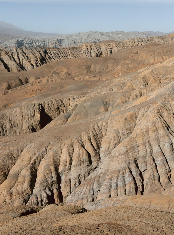 Layers of colourful and strangely formed mountains in Upper Mustang