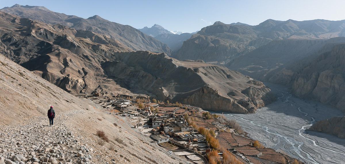 A trekker descending the stony trail to Tangge village on the Upper Mustang Trek