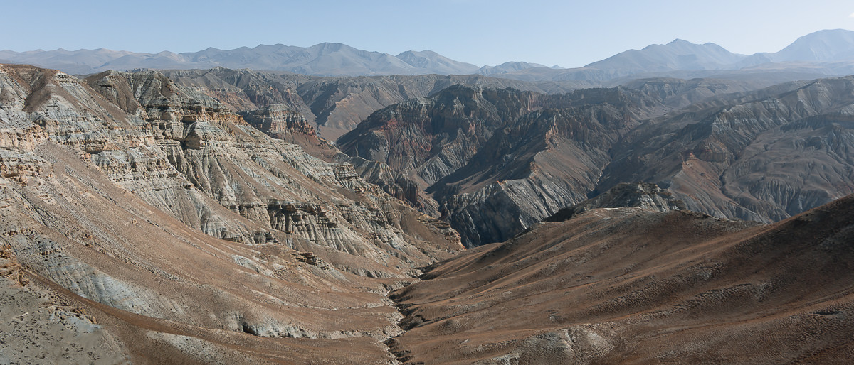 Jagged and colourful mountains stretching out across the land in Upper Mustang