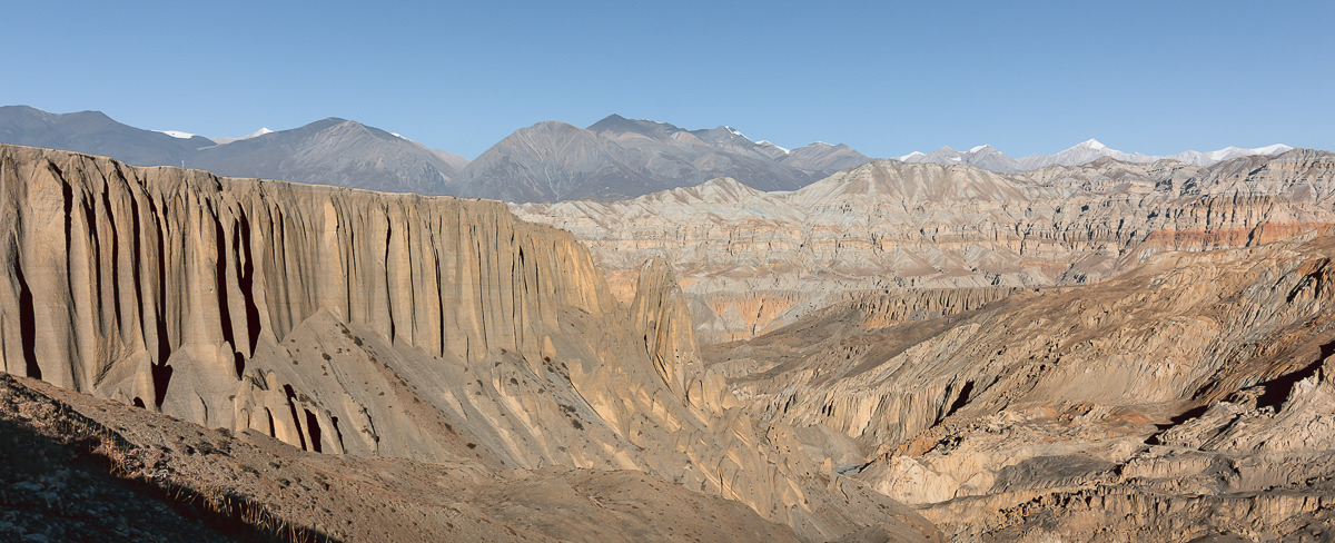 A panorama view of the bizarre rock formations and colourful mountain ridges of the Yara valley in Upper Mustang
