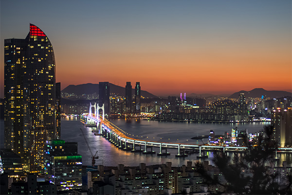 Busan City Guide: Sunset glow as the city lights turn on. View over Busan from Ganbiosan Bongsudae