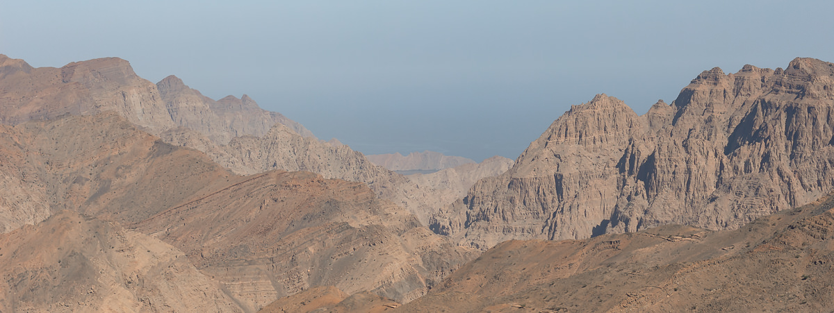 View from Musandam mountains to Limah at the coast on a hazy day (M)