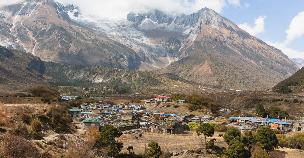 A view of the blue roofs of Samagaun with the mountains rising behind