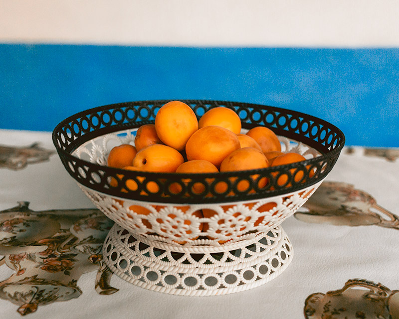 A bowl of fresh orange apricots on a table
