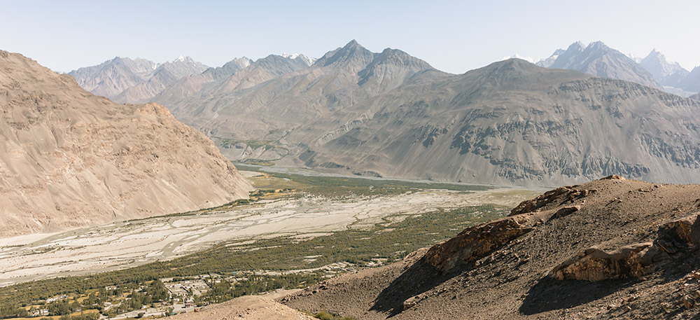 A view from high on a mountain trail of Langar in the Wakhan Valley, a regular stop for people doing a Pamir Highway Road Trip