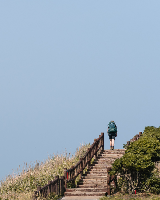 Walking round the coastal path at Songaksan on jeju Olle Trail Route 10