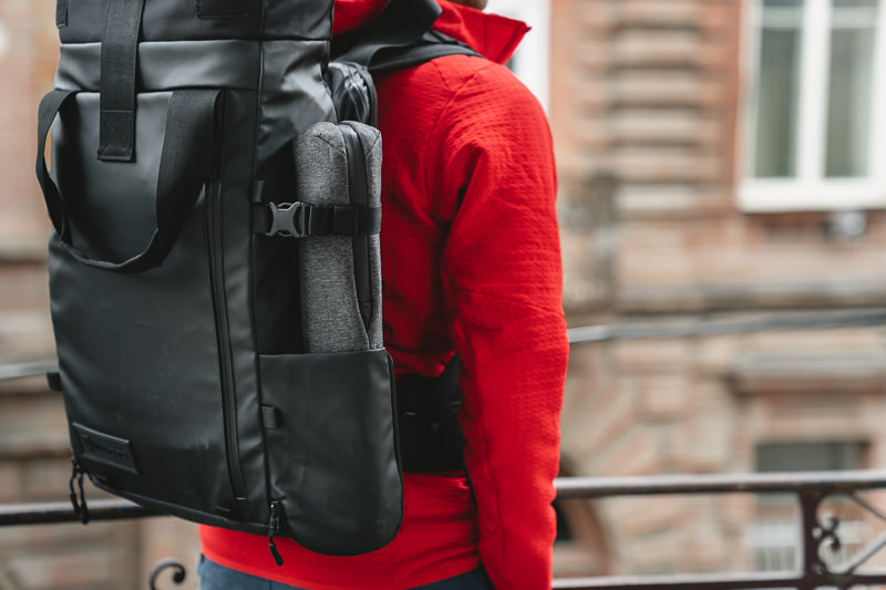 A close up of the Peak Design Travel Tripod in the side pocket of the Wandrd Prvke 31 travel camera bag