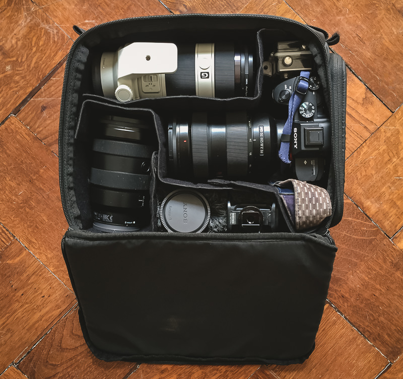 Wandrd Prvke camera cube packed with cameras and lenses for carrying separately from the main bag