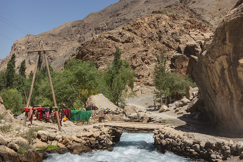 Independent Trekking In The Fann Mountains, Tajikistan: Haft Kul to Alauddin - Washing drying on the rocks by the Shing River