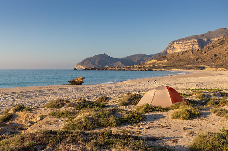 The tent is pitched in the low dunes with a view of the sea, one of the best campsites in Oman.