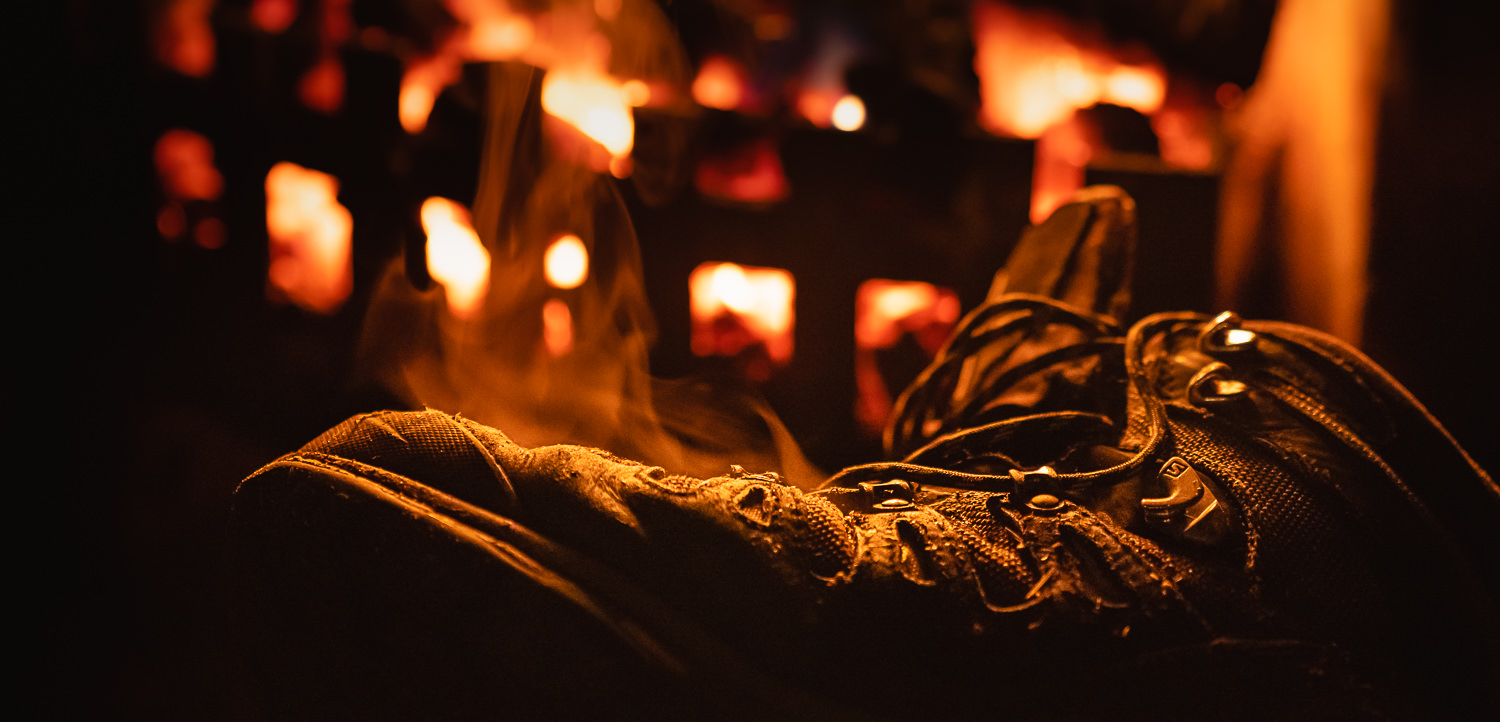 A wet boot steaming next to the fire in a Scottish bothy