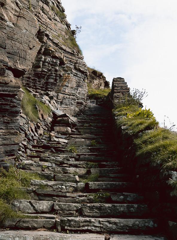 The Whaligoe stone steps descending a rocky cliff face on Scotland's far northeast Caitness coast.