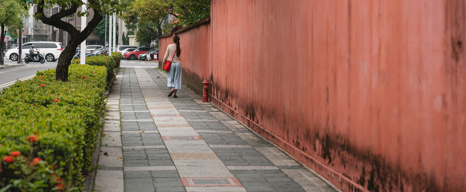 Woman walking outside Confucius Temple in Tainan