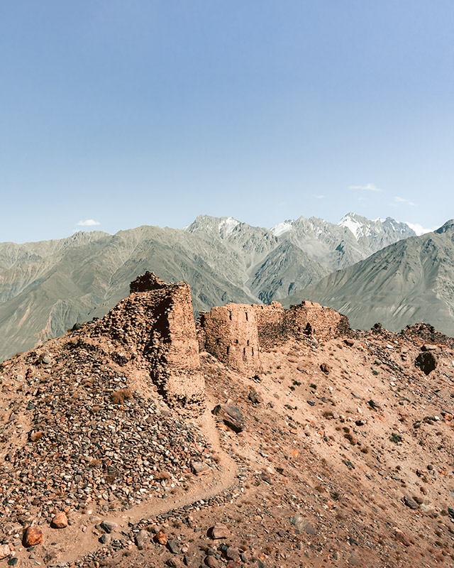 Crumbling Yamchun Fort with snowy mountain peaks behind