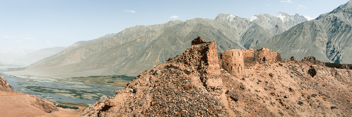 The ruins of Yamchun fortress sitting on a rocky outcrop high above the Wakhan Valley and one of the real highlights of a Pamir Highway Roadtrip